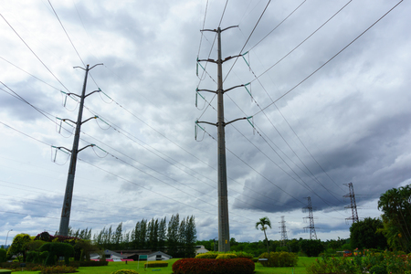 high tech: high voltage electricity pylon and transmission line in the filed Stock Photo
