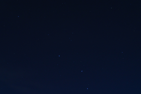 hole: night sky with star.