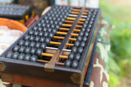 close up of wood abacus. chinese vintage calculator use for calculation in business or finance and education. Stock Photo