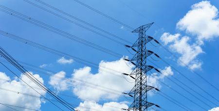 high tech: 230kv high voltage electricity pylon and transmission line with blue sky and cloud