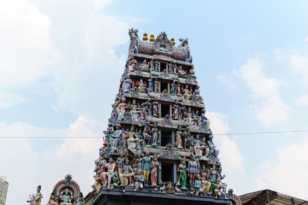sri mariamman temple with blue sky and cloud.top of ancient hindu temple detail with blue sky and cloud Stock Photo