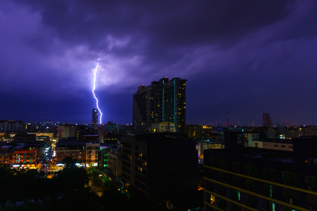 beautiful panorama landscape of pattaya cityscape at night and hit by lightning or thunderclap. cityscape at night with dark purple sky and cloud when lightning