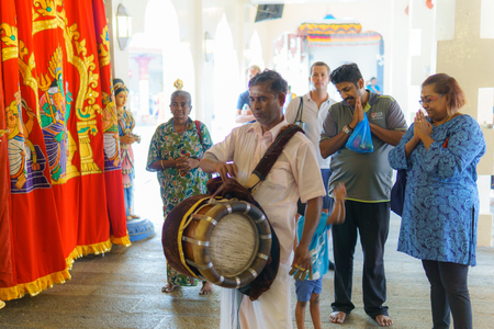 Singapore, October 21, 2017. Hindu musicians are playing music to celebrate the gods in the temple. Editorial