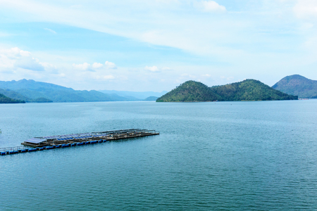 panorama landscape view of mountain and water in the dam with solar farm float on the surface of water for generate electricity from sun power. nature and technology or energy concept