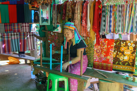 Mae Hong Son,Thailand.December 31,2017. Karen Long Neck villager selling local good and fabric at they shop in the village. Villagers are weaving the traditional way.