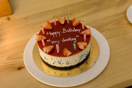 Happy Birth Day Blueberry Cheese Cake for lover or darling with candle and text happy birthday my darling on the surface. HBD celebration cake. Stock Photo - 99047647