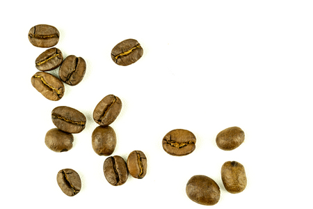 close up of medium or dark roasted coffee beans isolated on white background, can be used as a background or graphic object in your ads. Stock Photo