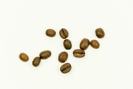 close up of medium or dark roasted coffee beans isolated on white background Standard-Bild