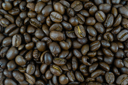 close up,pile of medium or dark roasted coffee beans. can be used as a background or graphic object in your ads.