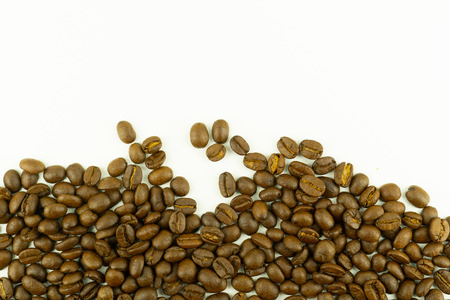 close up of medium or dark roasted coffee beans isolated on white background, can be used as a background or graphic object in your ads. Standard-Bild