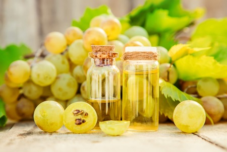 grape seed oil in a small jar. Selective focus. nature. Stock Photo