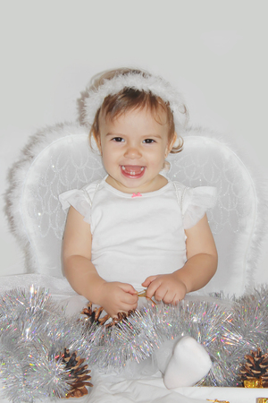 little child in the costume of an angel. Selective focus.