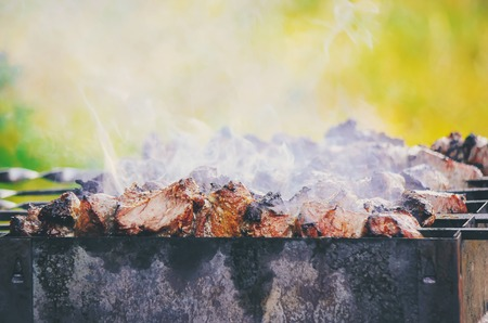 The meat is fried on the grill. Selective focus. Stock Photo