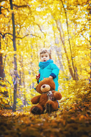 Child and autumn. Selective focus. nature. people.