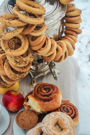 samovar tea, a bagel and buns with poppy seeds. Stock fotó