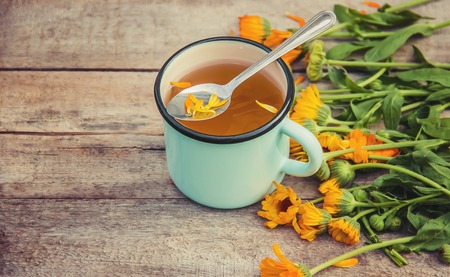 calendula tea and flowers. Selective focus. nature drink