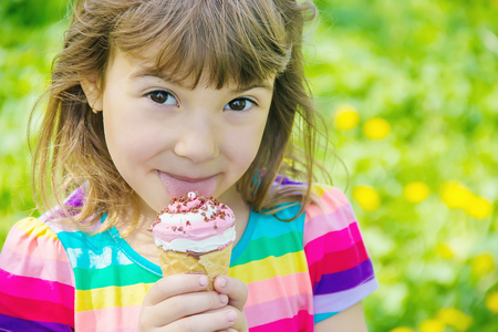 The child eats ice cream. Selective focus. Stock Photo