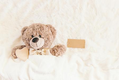 children's toy sleeps under the blanket. copy space. Selective focus. Kids.