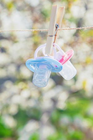 Baby clothes and accessories weigh on the rope after washing in the open air. Selective focus. nature.