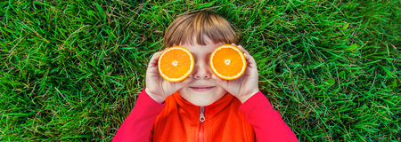 Child on a picnic with juice and fruit. Selective focus. Stockfoto