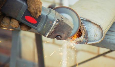 cut metal repair machine muffler. Selective focus. nature 版權商用圖片