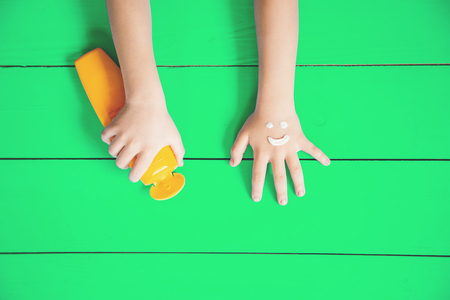 Sunscreen on the hand of a child. Selective focus. nature. Stock Photo