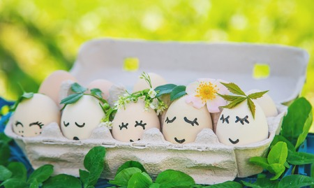 homemade eggs with beautiful faces and a smile. Selective focus. nature.