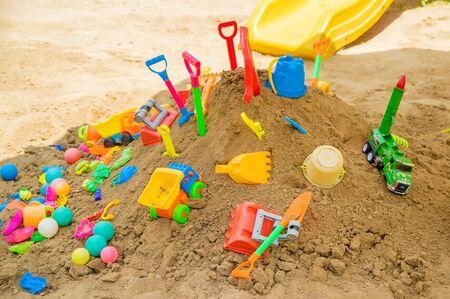 lot of children's toys in the sandbox. Selective focus. nature. Standard-Bild