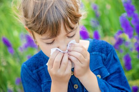 Seasonal allergy in a child. Coryza. Selective focus.