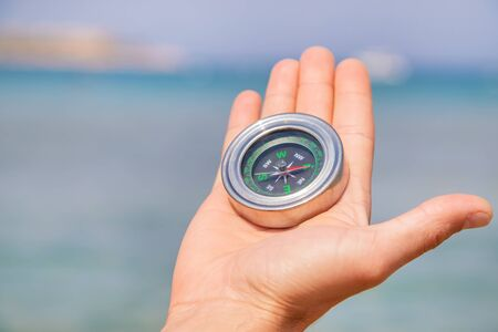 compass on the sea coast. Selective focus. nature