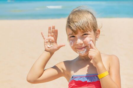 Sunscreen on the skin of a child. Selective focus. Stock Photo