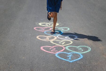 Childrens hopscotch game on the pavement. selective focus. nature.