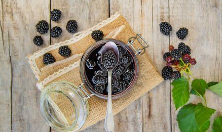 Blackberry jam in a jar. Selective focus. nature Фото со стока