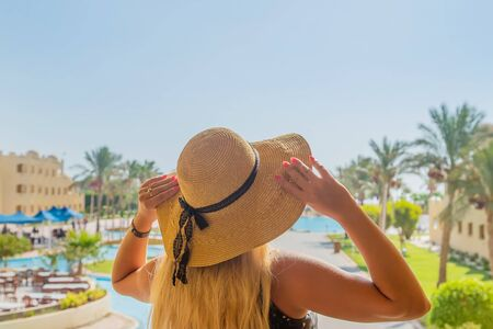 girl looks at the pool and sea. Selective focus. nature.