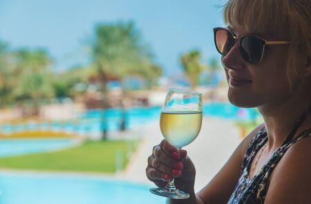 Drink wine by the sea. Selective focus. Фото со стока