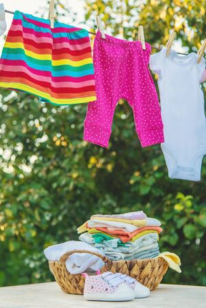 washing baby clothes. Linen dries in the fresh air. Selective focus. nature.
