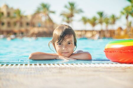 the child swims and dives in the pool. Selective focus. Фото со стока