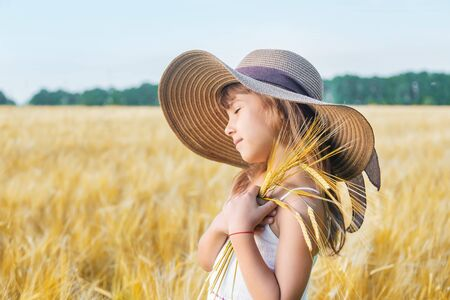 A child in a wheat field. Selective focus.