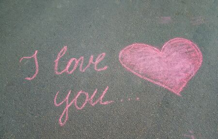 Declaration of love in chalk on the pavement. Selective focus. nature.