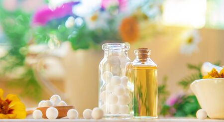 Homeopathy. Herbal extracts in small bottles. Selective focus. nature. Stock Photo