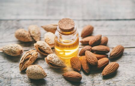 Almond essential oil in a small bottle. Selective focus. nature. Stockfoto