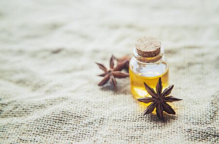 Star anise oil in a small bottle. Selective focus. nature.