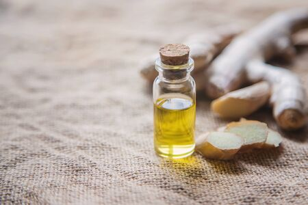 Ginger essential oil in a small bottle. Selective focus. nature. Stock Photo