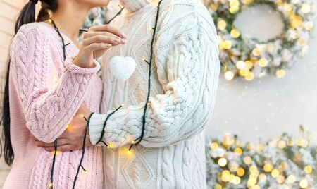 Lovers man and woman on a Christmas background. Holiday. Selective focus. Stock Photo - 133228994