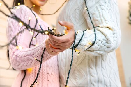 Lovers man and woman on a Christmas background. Holiday. Selective focus. Stock Photo