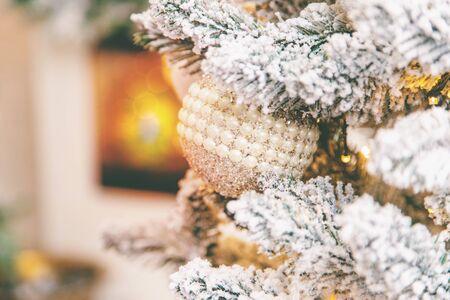 Christmas background fireplace and Christmas tree. Selective focus. Holiday.