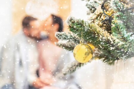 Lovers man and woman on a Christmas background. Selective focus. Holiday.