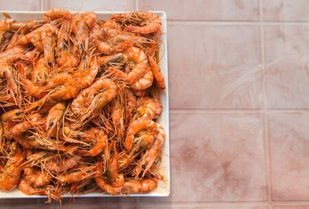 Large shrimp on a plate. Selective focus. Food.
