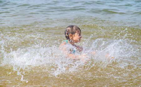 A child drowns in water at sea. Selective focus.