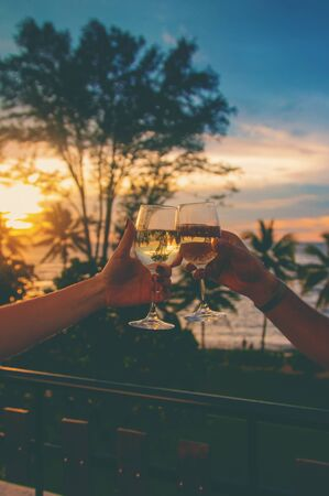 With glasses of wine at sunset. Selective focus. Drink.